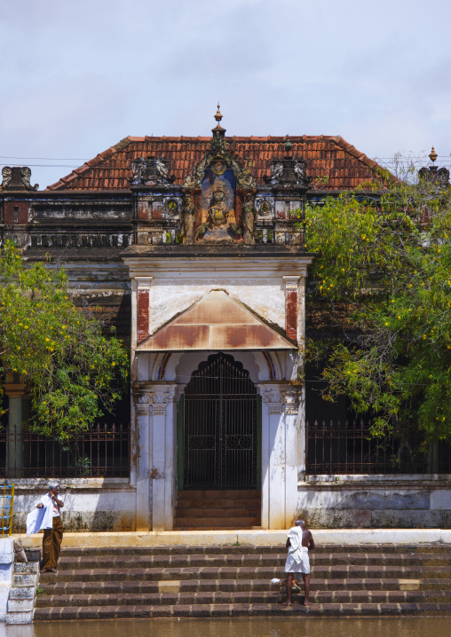 Men On The Stairs Around A Pond In Front Of A Chettiar Mansion, Kanadukathan Chettinad, India