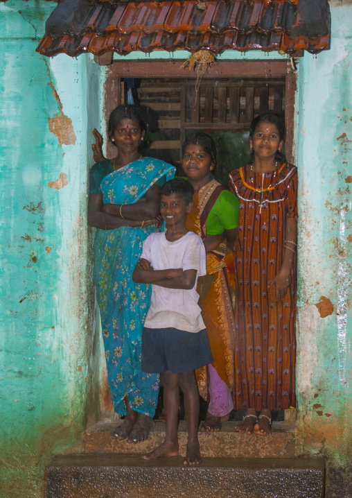 Mother Posing With Her Children On The Doorstep Of Their House Kanadukathan Chettinad, India