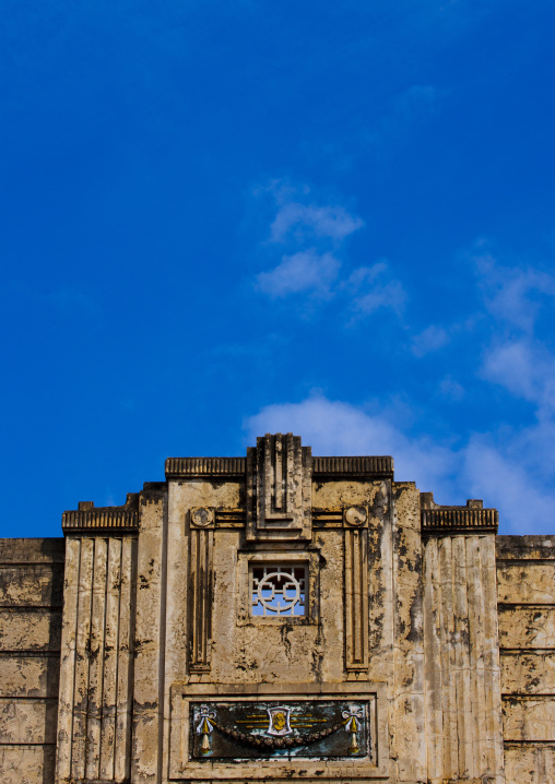 Adornment On The Top Of An Old Decrepit Building Over A Blue Sky, Kanadukathan Chettinad, India
