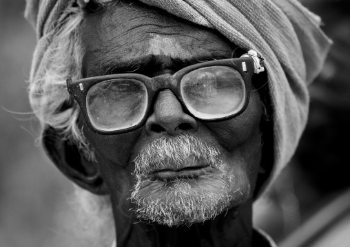 Old Keeper Of The Ayyanar Temple Wearing Glasses And A Turban, Pudukkottai, India