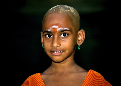 Young Girl With Shaved Head Covered With Sandalwood Paste In Sri Ranganathaswamy Temple, Trichy, India