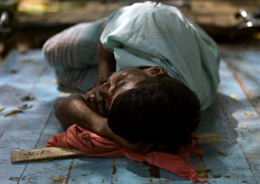 Man Wearing A Mustache Sleeping On The Ground At Madurai Market, India