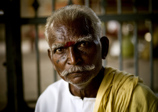 Old Indian Matchmaker With Gray Hair And A Mustache Looking For Bachelors In A Temple, Madurai, India