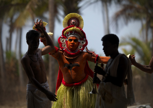 Theyyam Artist Performing Ritual Attented By Priests, Thalassery, India