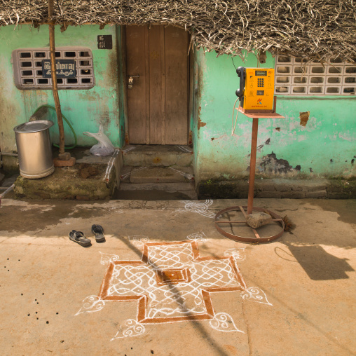 Kolam Drawned In Front Of House With Green Decrepit Wall And A Public Phone, Kumbakonam, India