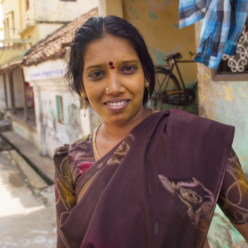 Indian Woman In Sari With Bindi On Her Forehead Posing In The Middle Of The Street And Smiling Shyly, Kumbakonam, India