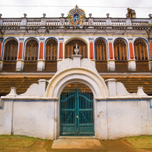 Padlocked Portal At The Entrance Of A Colorful Chettiar Mansion With Religious Carvings On The Top, Kanadukathan Chettinad, India