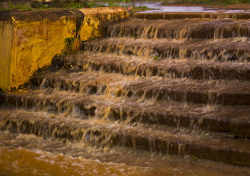 Rainstorm Flowing Over Stairs Forming A Small Waterfall, Kanadukathan Chettinad, India