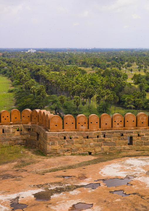 Views Over The Countryside Behind The Carved Stone Blocks On The Rampart Of The Tirumayam Fort, Tirumayam, India