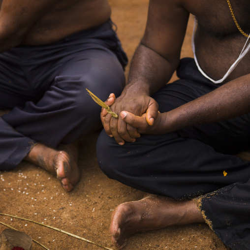 Shirtless Men Sitting On The Ground Clapping Their Hands During A Wedding, Trichy, India
