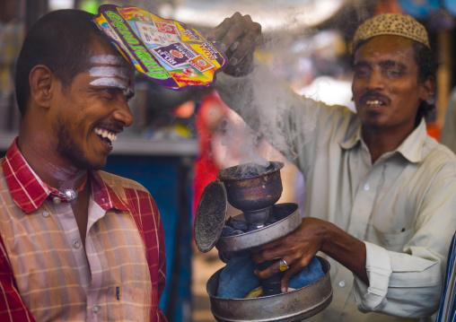 Men During Insence Purification On Madurai Market, India