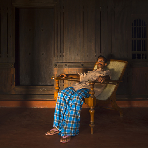 Man Resting In A Long Chair, Alleppey, India