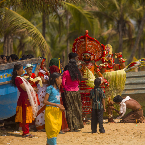 Theyyam Dancers In The Audience During Theyyam Ceremony On The Beach, Thalassery, India
