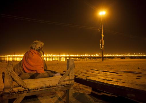 Old Man Sleeping On The Riverbank, Maha Kumbh Mela, Allahabad, India