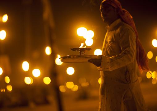 Man Holding Sacred Fire, Maha Kumbh Mela, Allahabad, India