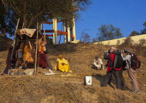Chinese Tourists Taking Pictures Of A Naga Sadhu Standing On One Leg For One Year, Maha Kumbh Mela, Allahabad, India