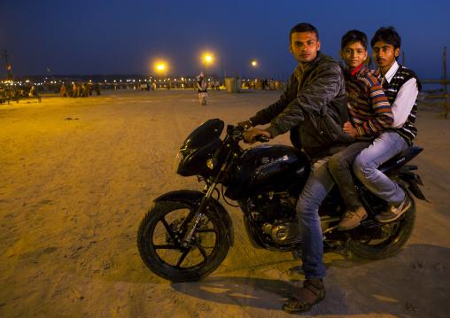 Pilgrims On A Moto At Maha Kumbh Mela, Allahabad, India