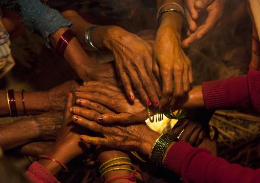 Women Putting Hands Over A Fire, Maha Kumbh Mela, Allahabad, India