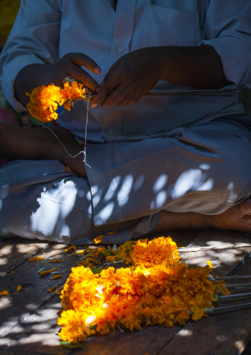Cross-legged Man Attaching Flowers On A Thin Woodenstick At Flower Market, Pondicherry, India