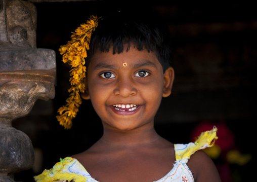 Portait Of A Smiling Gap-toothed Young Girl With Flowers In Her Hairs, Kumbakonam, India