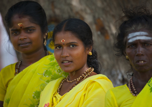 Three Women In Yellow Sari With Necklace Waiting To Cross The Street, Trichy, India