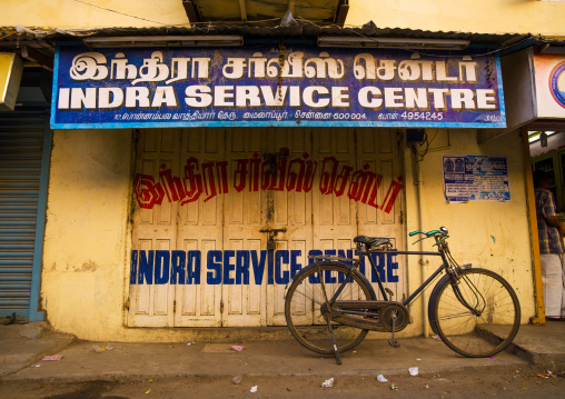 Old Bicycle On Kickstand Parked In Front Of A Closed Store In Chennai, India