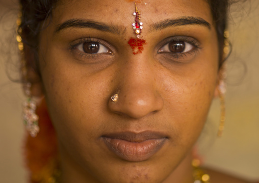 Close Up Of A Young Indian Woman With Traditional Painting On Her Forehead And A Nose Piercing, Madurai, India