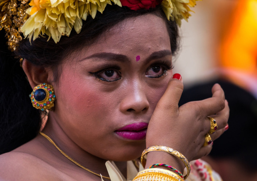 A Teenager Girl In Traditional  Costume Crying Before A Tooth Filing Ceremony