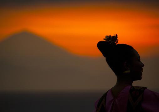 Dancer In Front Of Gunung Agung Volcano At Sunset, Mataram, Lombok Island, Indonesia