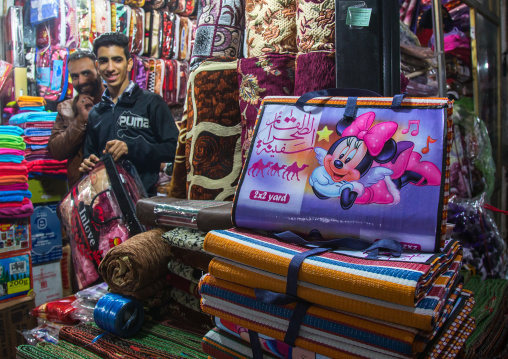 Vendors in the bazaar with minnie mouse logos on blankets, Hormozgan, Bandar abbas, Iran