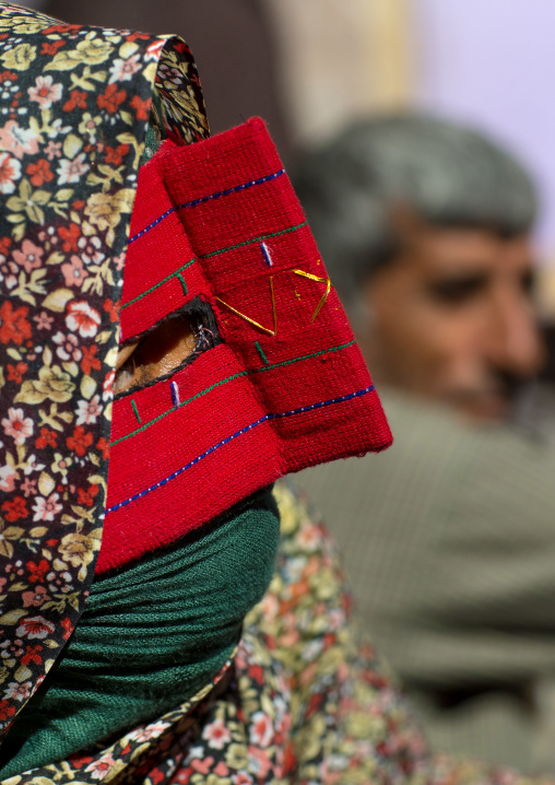 A bandari woman wearing the traditional mask called the burqa on a market, Hormozgan, Bandar abbas, Iran