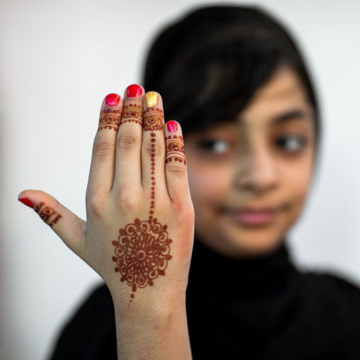 portrait of a young girl with henna tattooed hands in traditional bandari clothing during a wedding ceremony, Hormozgan, Bandar-e Kong, Iran
