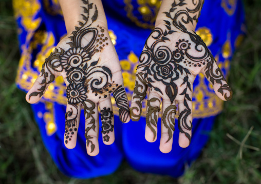 Little girl with henna painted hands, Hormozgan, Bandar-e kong, Iran