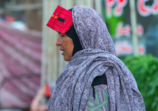 A bandari woman wearing a traditional mask called the burqa at panjshambe bazar thursday market, Hormozgan, Minab, Iran