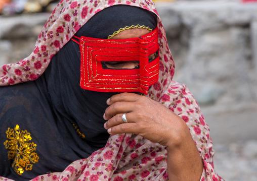 A bandari woman wearing a traditional mask called the burqa at panjshambe bazar thursday market, Hormozgan, Minab, Iran