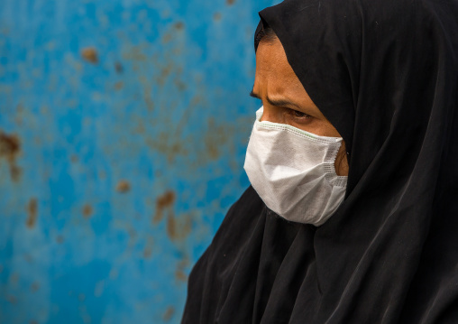 A woman wearing a face mask to protect from h1n1 influenza in panjshambe bazar, Hormozgan, Minab, Iran