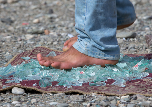 Man walking on broken glass, Hormozgan, Minab, Iran