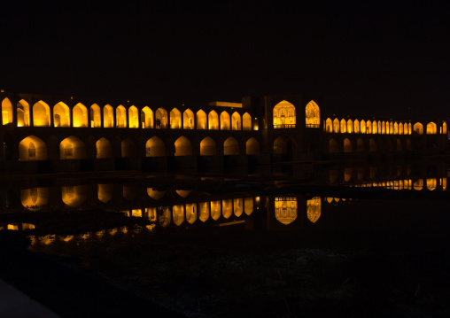 A view of the khaju bridge at night highlighting the arches, Isfahan province, Isfahan, Iran