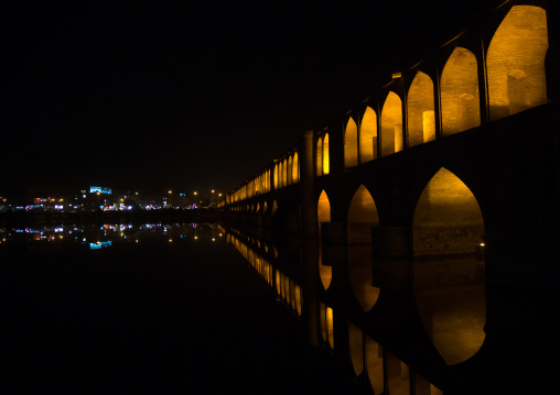 A view of the si-o-seh bridge at night highlighting the 33 arches, Isfahan province, Isfahan, Iran