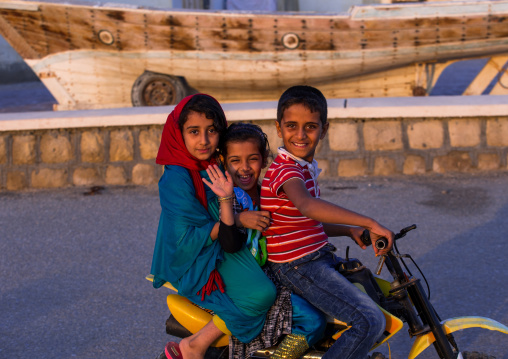 Children riding a motorbike, Qeshm island, Laft, Iran