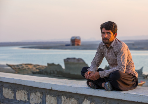 a man sitting by the sea, Qeshm Island, Laft, Iran
