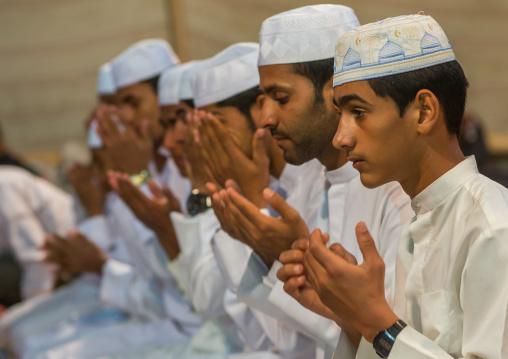 men praying during a wedding ceremony, Qeshm Island, Tabl , Iran