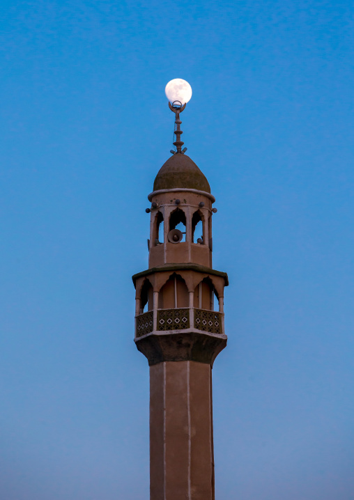 minaret of a mosque at dusk with the full moon, Qeshm Island, Salakh, Iran