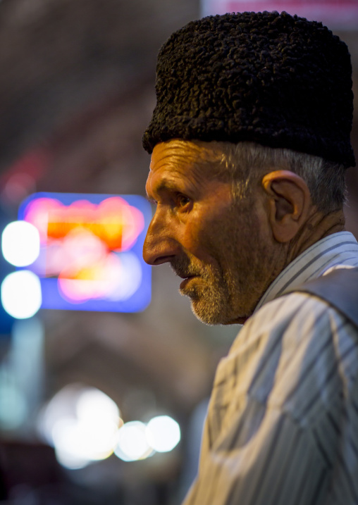 Old man with a wool hat inside the old bazaar, Tabriz, Iran