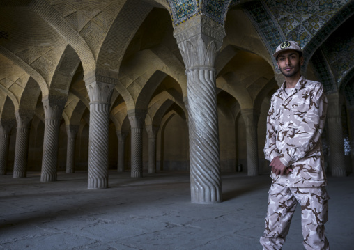 Soldier inside vakil mosque prayer hall, Fars province, Shiraz, Iran