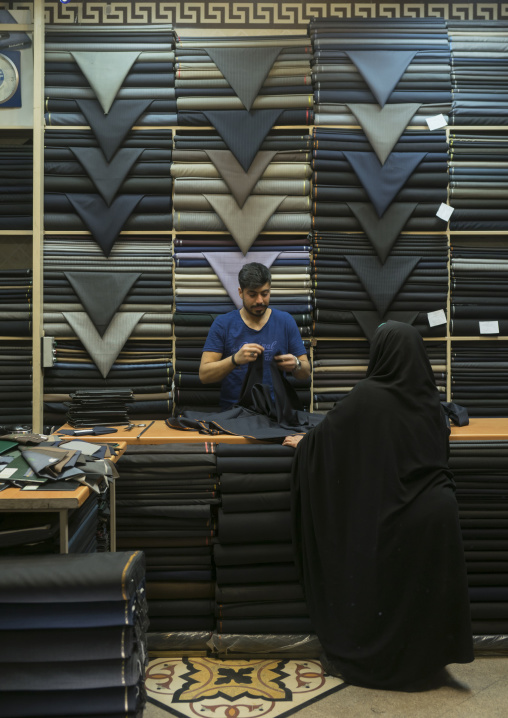 Fabric store with stacks of textiles in the bazaar, Shemiranat county, Tehran, Iran