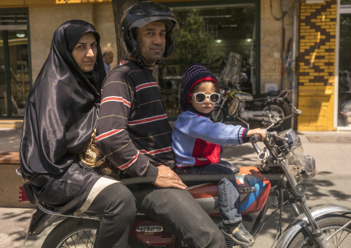 Family on a motorbike, Shemiranat county, Tehran, Iran