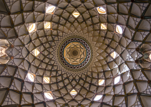 Ceiling with its intricate and elaborate patterns and internal stainless glass dome the boroujerdi house, Isfahan province, Kashan, Iran