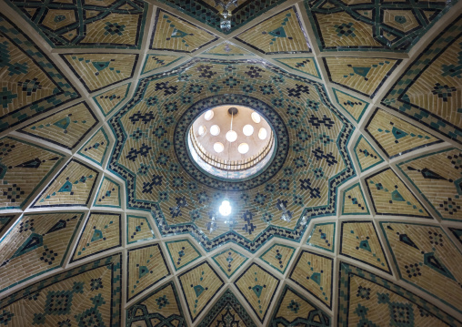 Ceiling with its intricate and elaborate patterns and internal stainless glass dome in sultan amir ahmad bathhouse ceiling, Isfahan province, Kashan, Iran