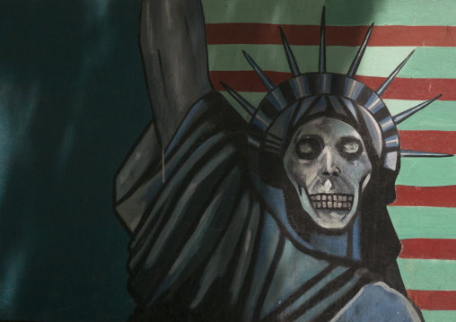 Anti-american mural propoganda slogan depict statue liberty skeleton on the wall of the former united states embassy, Shemiranat county, Tehran, Iran